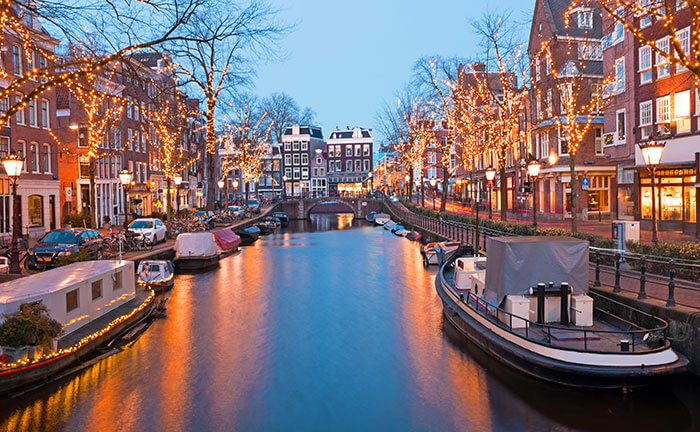 Canal in Amsterdam with Christmas lights