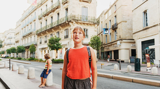 Girl wearing a red top in the streets of Marseille