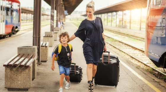lilttle boy with mother on station platform